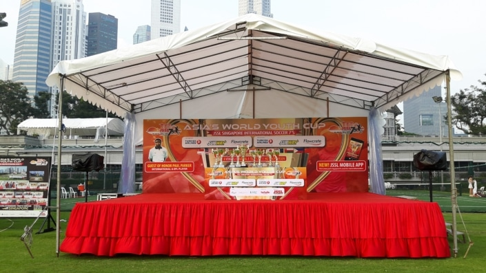 A-Shaped Tentage with Red Stage and Backdrop