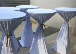cocktail table with white spandex cloth with tassel