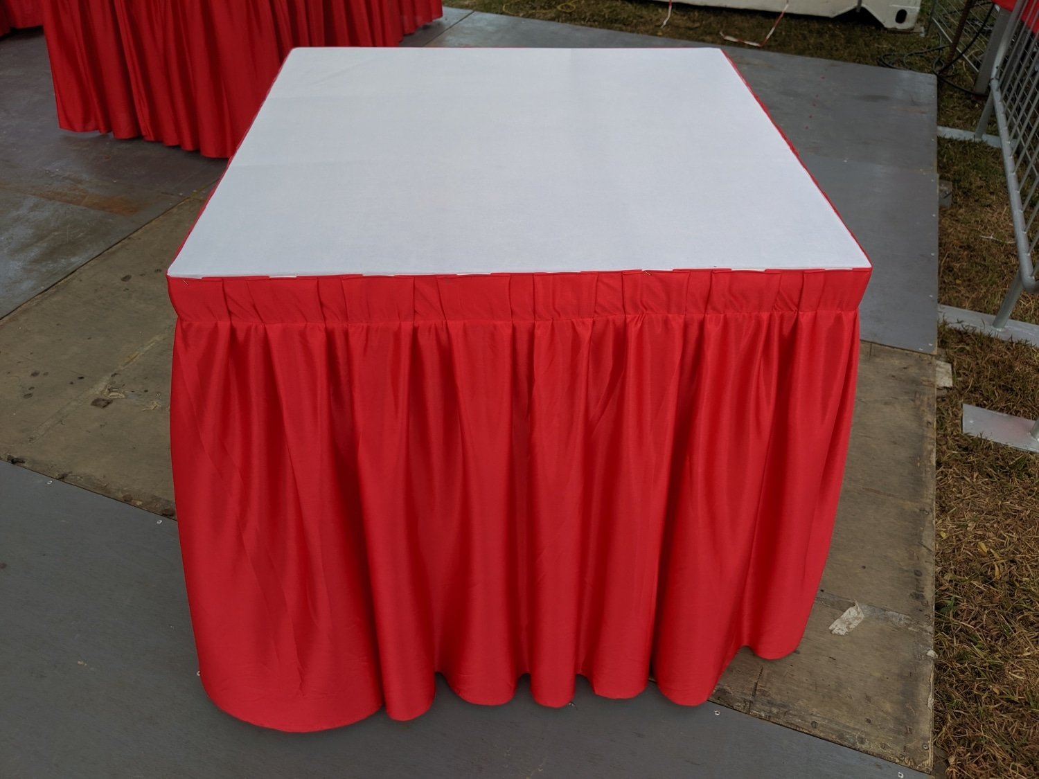 square table with table cloth and skirting