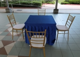 square table with blue table cloth