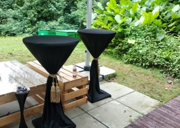 black cocktail table with gold tassel